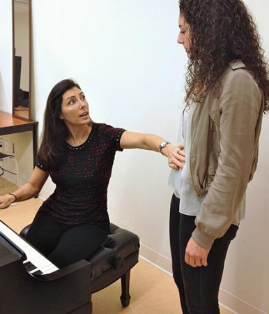 Aimée Steele in the studio teaching a student.